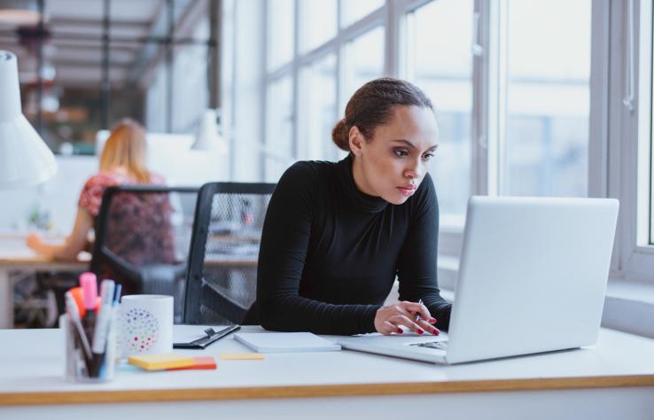 woman at work looking at laptop