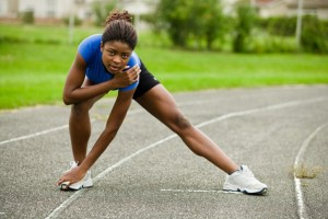 Woman stretching on track