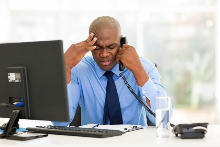 stressed businessman on phone