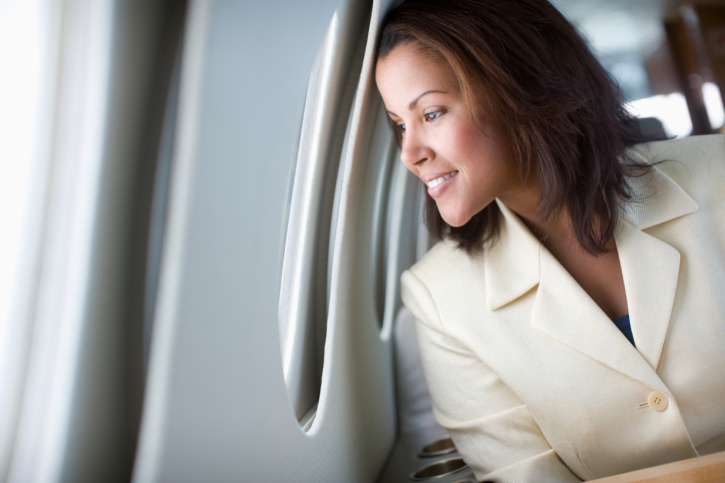 Businesswoman Looking out Airplane Window