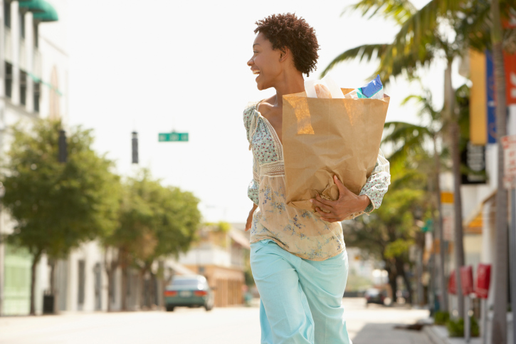 Woman Walking carrying groceries