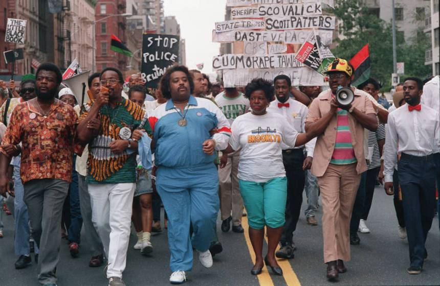 Advisers to Tawana Brawley, Attorney C. Vernon Mason, second from left, the Rev. Al Sharpton, center, and attorney Alton Maddox, lead a march toward Mayor Ed Koch's residence at Gracie Mansion in New York City on Sunday, Aug. 28, 1988. The others in the front are unidentified. (AP Photo/Charles Wenzelberg)