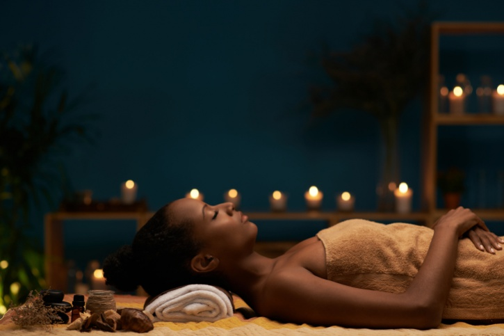 woman relaxing with candles