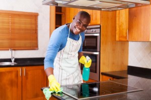 african american man cleaning stove