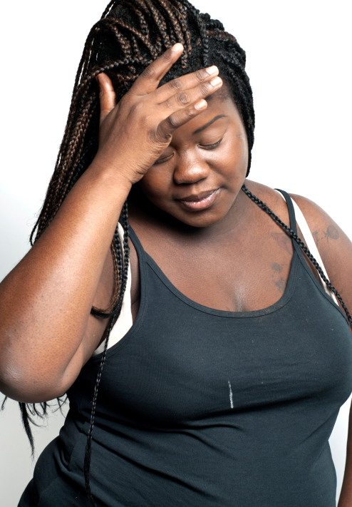 Plus Size African American Woman In Dispair And Distraught