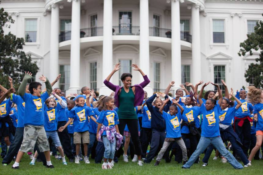 First Lady Michelle Obama leads a group of 400 local children on the South Lawn of the White House to help break the Guinness World Records title for the most people doing jumping jacks in a 24-hour period, Oct. 11, 2011. (Official White House Photo by Chuck Kennedy)