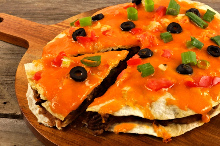 Mexican pizza close up on wooden server