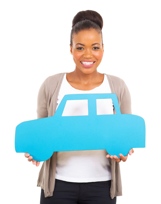 African American woman holding car sign
