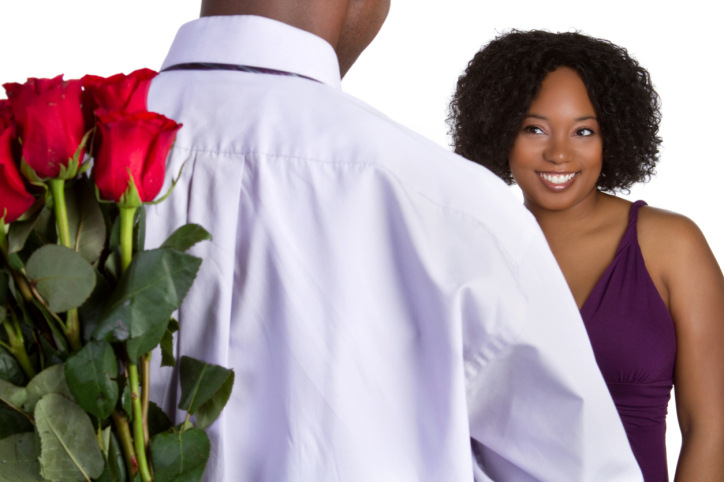 African American couple happy man holding flowers