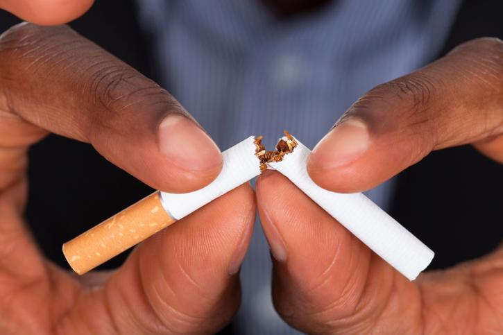 African American man hands breaking cigarette
