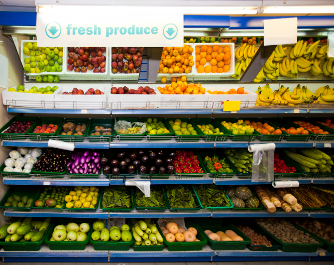 Various vegetables and fruits on display in grocery store
