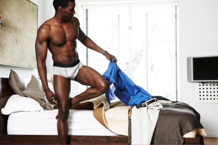 African American man getting out of bed