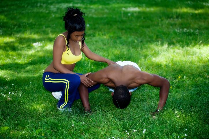 Black couple exercising outside