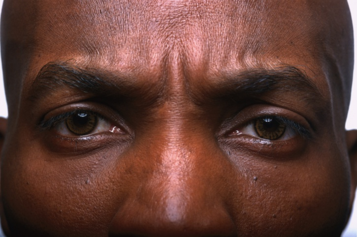 close up African American man's eyes