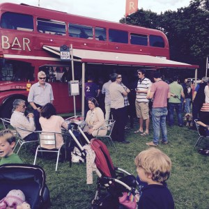 A Pint in the Sun with Big Red Bus Bar...