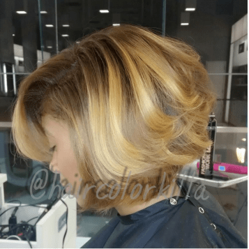 Flat ironed honey-blonde bob.