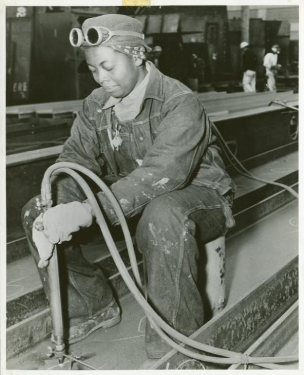 Anna Bland, a burner, is shown at work on the SS George Washington Carver as it was being rushed to completion in the spring of 1943. Source