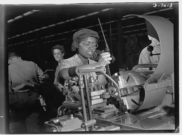 Plant foremen point to 20-year-old Annie Tabor as one of their best lathe operators, despite her lack of previous industrial experience. Employed by a large Midwest supercharger plant, this young woman machines parts of aircraft engines. Source