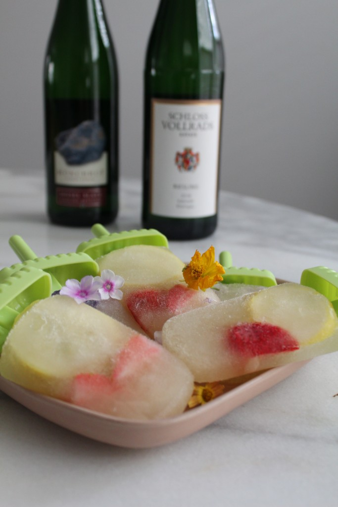 Riesling Pops on plate with Wine Bottles in the Foreground