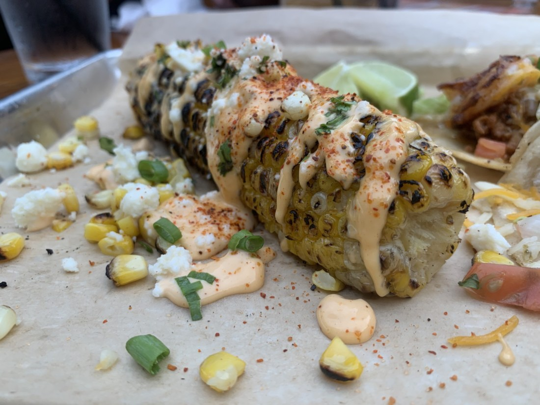 Corn on the cob with toppings
