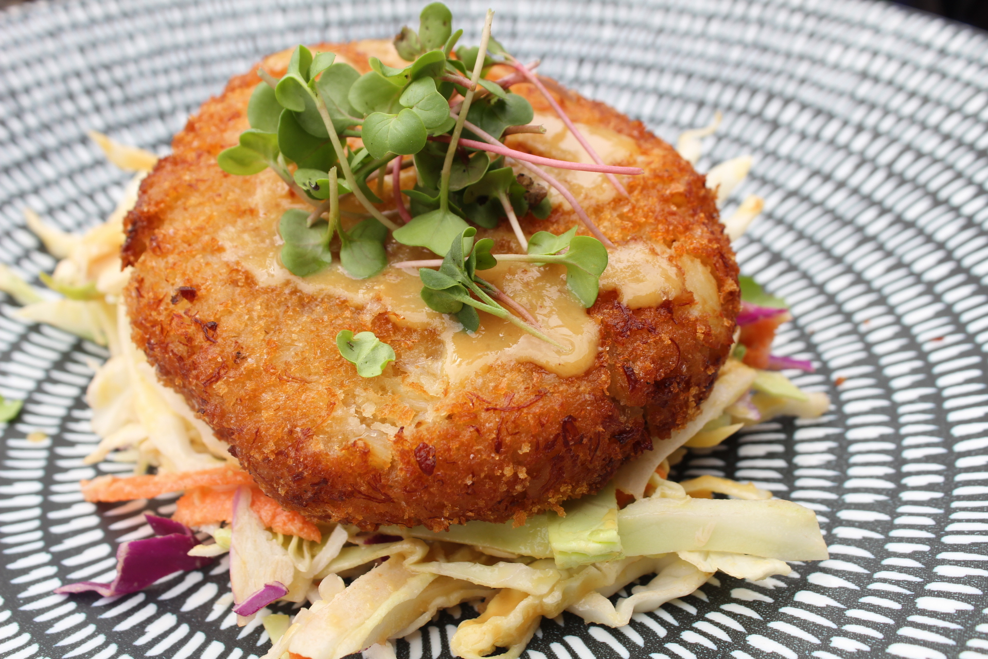Crab Cake on top of slaw on a plate