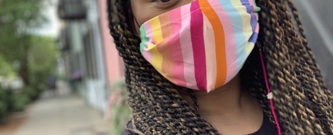 Rainbow Row with woman wearing rainbow cloth mask and braids