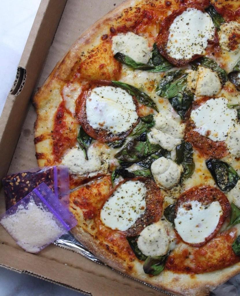 Pizza topped with mozzarella
