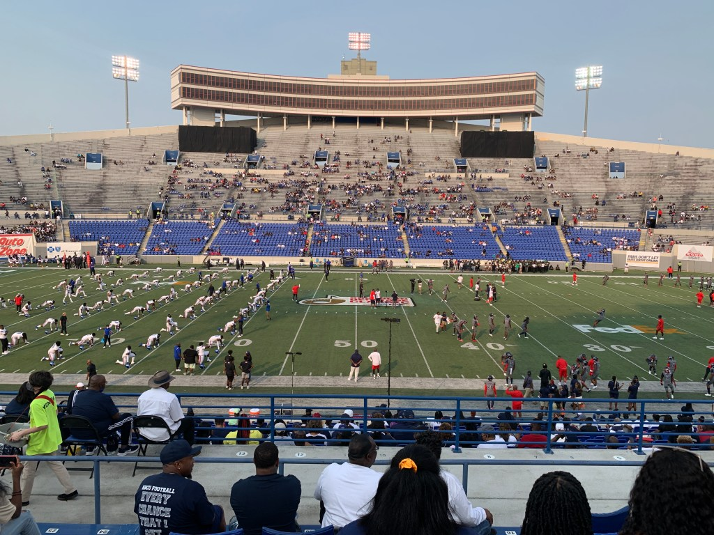 Photo of the 50 yard line and players from TSU and JSU warming up