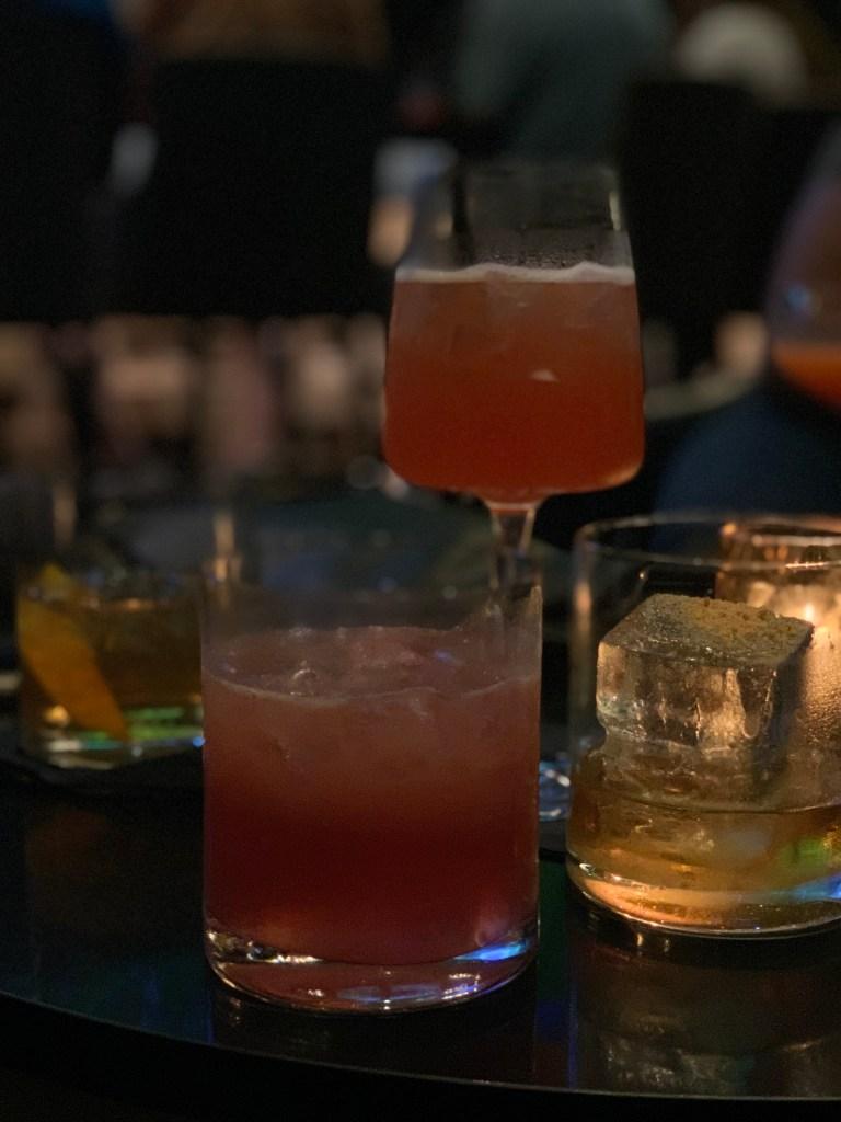 Dark photo of four cocktails from Hyatt Centric