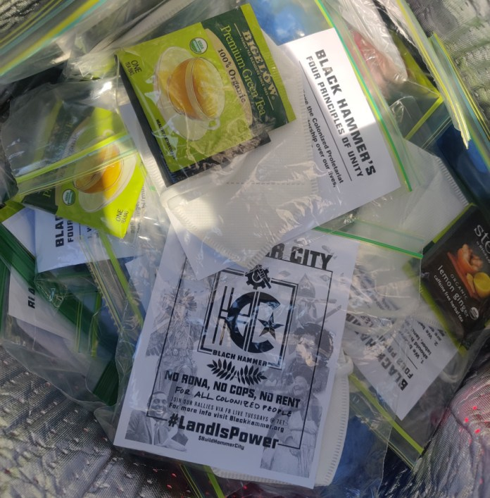 Bags of masks and hammer city fliers