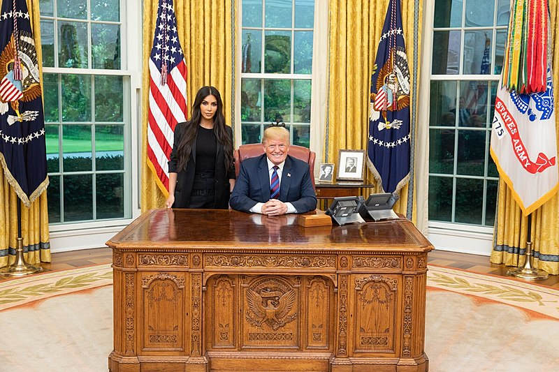 Trump and Kim sitting in the oval office