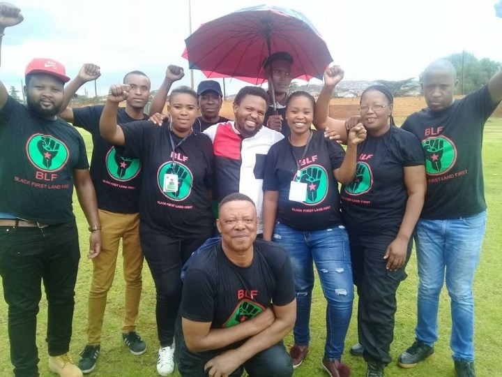 BLF members in a field raising fists