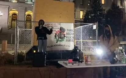 Gazi gives a speech at one of the vigils