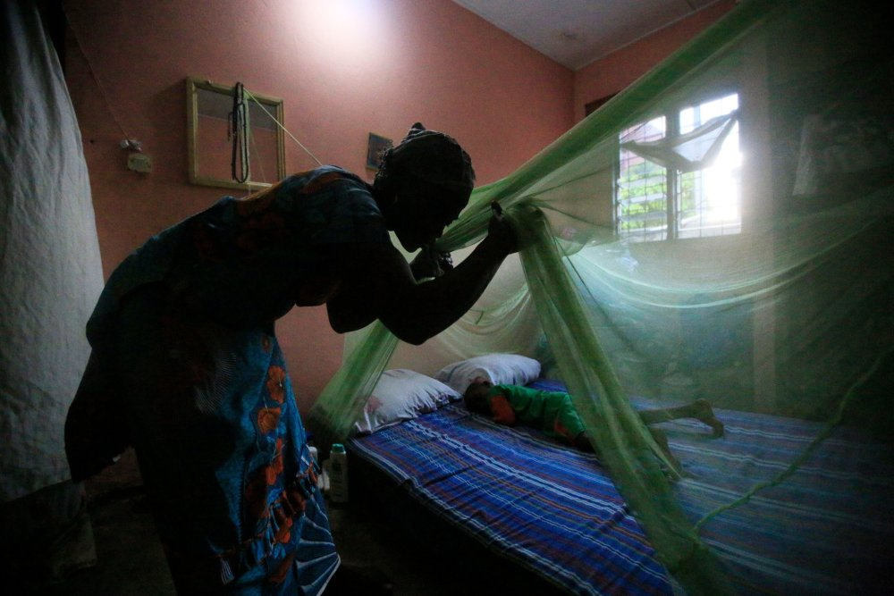 A Long Lasting Insecticidal Net being used for the purposes of protecting a child