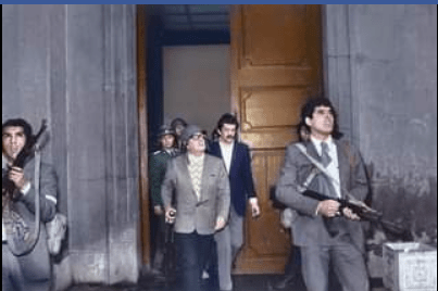 One of the last photos of Salvador Allende as he took his last stance against colonialism, protecting the presidential palace against the u.$ backed coup