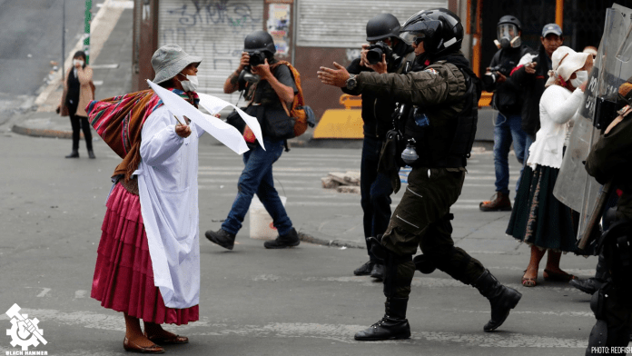 Indigenous woman marches against the coup in Bolivia.