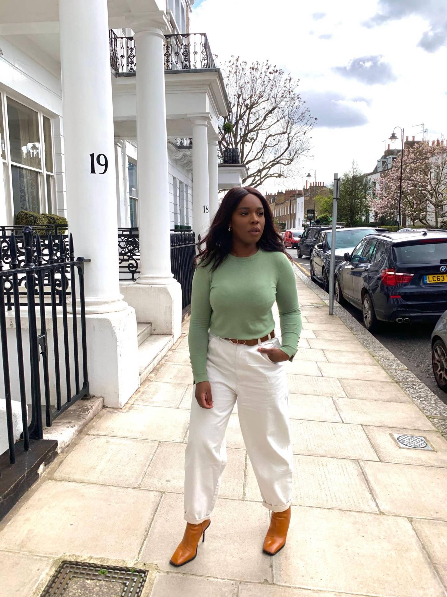 black woman wearing a white slouchy jeans in London