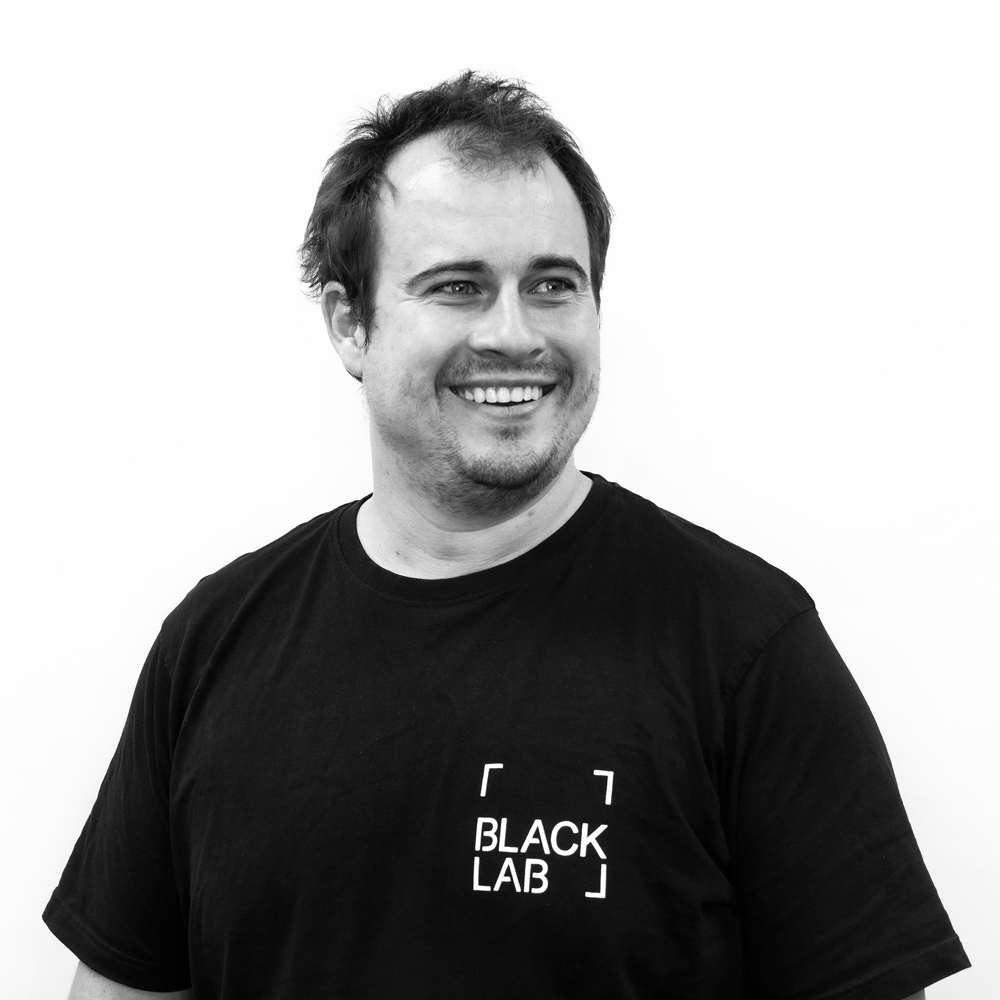 ceo daen simmat smiling in black and white