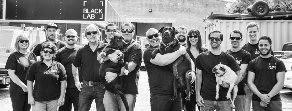 black lab team photo in black and white