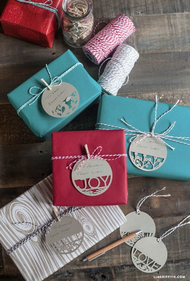 https://liagriffith.com/paper-cut-holiday-gift-tags/