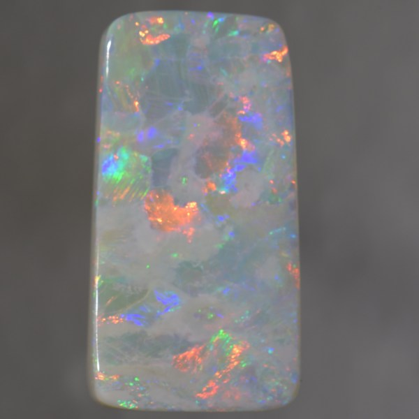 This is a verylarge Dark Opal with beautiful flashingcolours ( blue green and orange ) and would be perfect for apendant