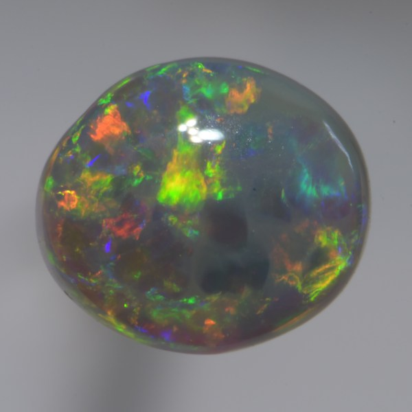 This beautiful Crystal Black Opal has mainly green and gold ( orange ) colours in a flagstone pattern with a thick translucent body. Ideal for a gold or silver ring.