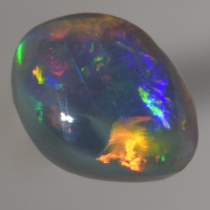 Beautiful Crystal Black Opal, very bright and lots ofcolour in a broad flash pattern would sit very nicely in a ring.