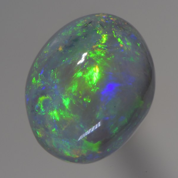 Very Bright Oval ( free form ) Opal has Flashing Green, Purple and red mixed with a stunning Broad Flash pattern and would make a mostglorious ring. Free worldwideshipping with postal Insurance included.No risk with our 30 days money back guarantee.If you would like this opal to be set in jewellery, please contact us for an instant quote.