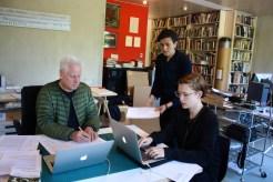 "Arnold Dreyblatt, Anna Schapiro, Project Coordinator, and Anne Steinhagen working on ""Performing the Black Mountain Archive"" at Dreyblatt's studio in Berlin ."
