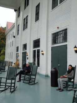 Eugen Blume and Matilda Felix sitting in rocking chairs on the porch of Blue Ridge Lee Hall of Black Mountain College near Asheville, North Carolina. Photo: Gabriele Knapstein, 2014.