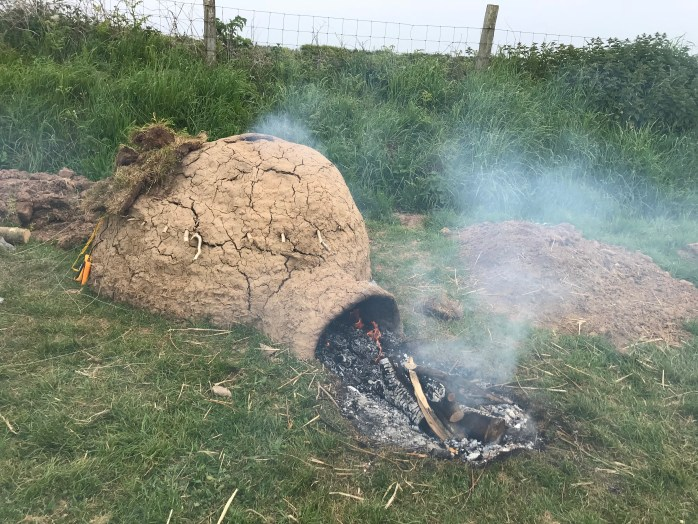 Reconstruction medieval corn drying oven during firing.