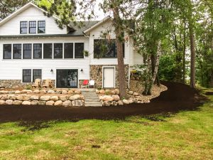 landscaping with boulder wall and patio