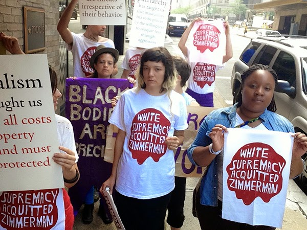"Image of women protesters holding signs ""White Supremacy Acquitted Zimmerman"""