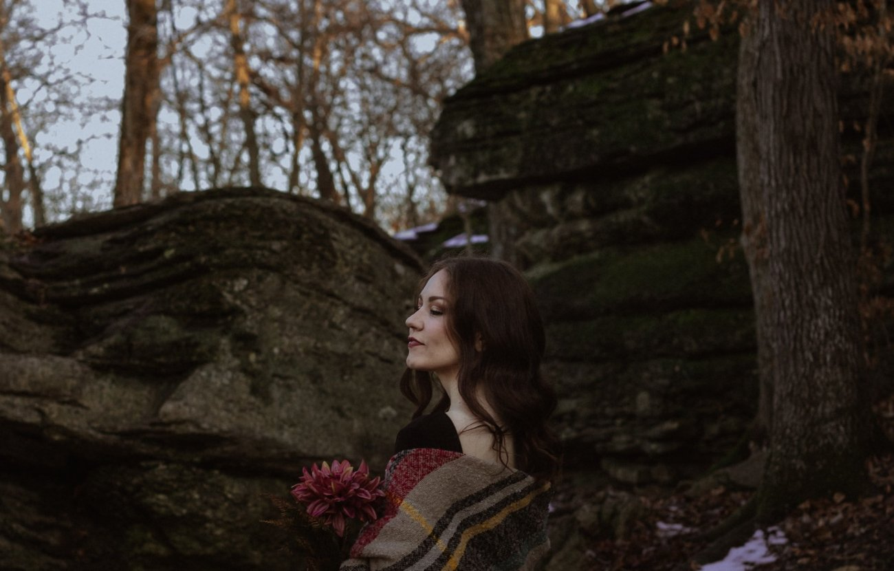 Girl looks over her shoulder by cliffs